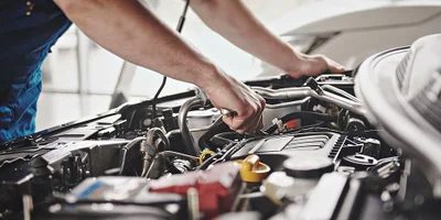 servicing car engine
